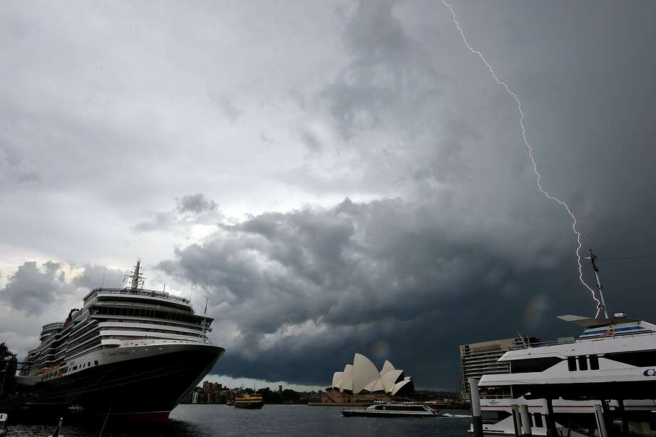 Batten down the hatches, mate:Lightning strikes over yachts and cruise ships in Sydney   Harbor. Photo: Saeed Khan, AFP/Getty Images