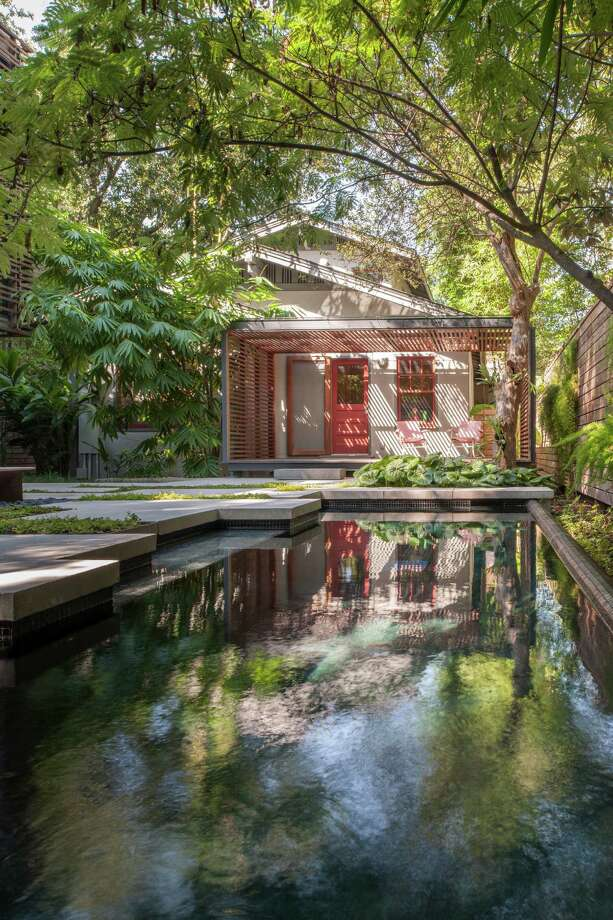 Homeowner Rachel Nystrom says her backyard pool occasionally is mistaken for a koi pond. Photo: Paul Hester, Photographer / ONLINE_YES