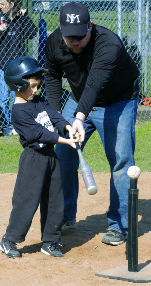 Coach Bob Gillette offers batting tips to T-ball hopeful Anthony Mascolo as New Milford Youth Baseball/Softball gets its 2013 season in full swing in April at the New Milford Farms fields complex along Boardman Road in New Milford. Photo: Norm Cummings / The News-Times