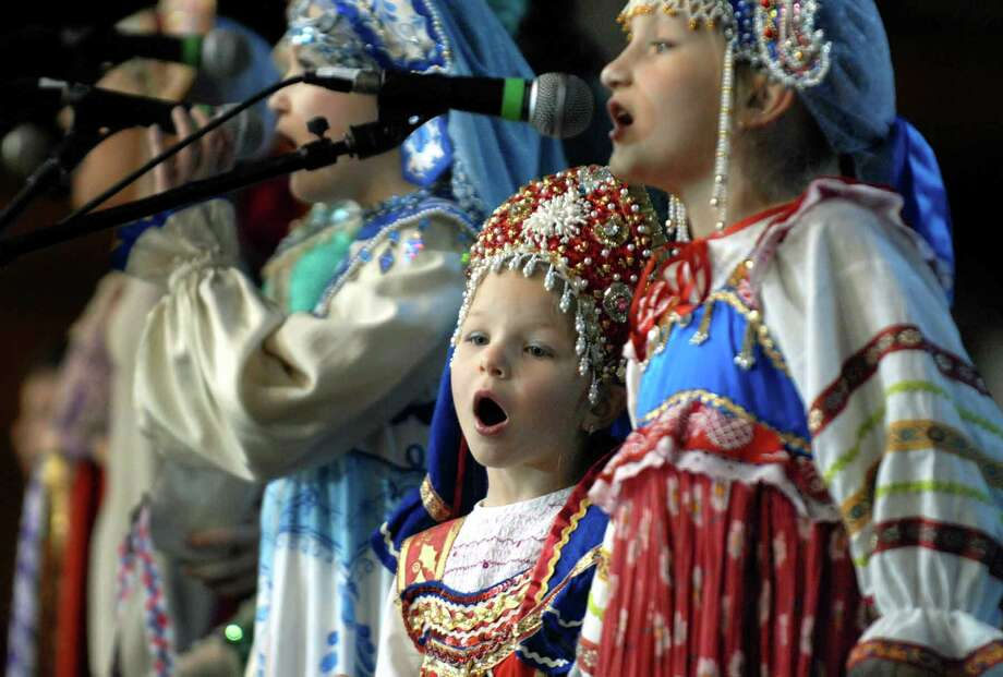 "Five-year-old Anita Lugina , center, of the Ensemble ""Golden Rooster"" perform traditional Russian songs during the Russian Winter Festival at The Wasington Armory in Albany,New York 02/13/2010.(Michael P. Farrell/Times Union) Photo: MICHAEL P. FARRELL / 00007513A"