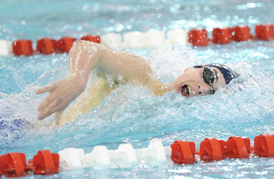 At left, Jonathan Blansfield of Staples competes in the 200 freestyle event that he won during the FCIAC Boys Swimming Championships at Greenwich High School, Thursday night, Feb. 27, 2014. Photo: Bob Luckey / Greenwich Time