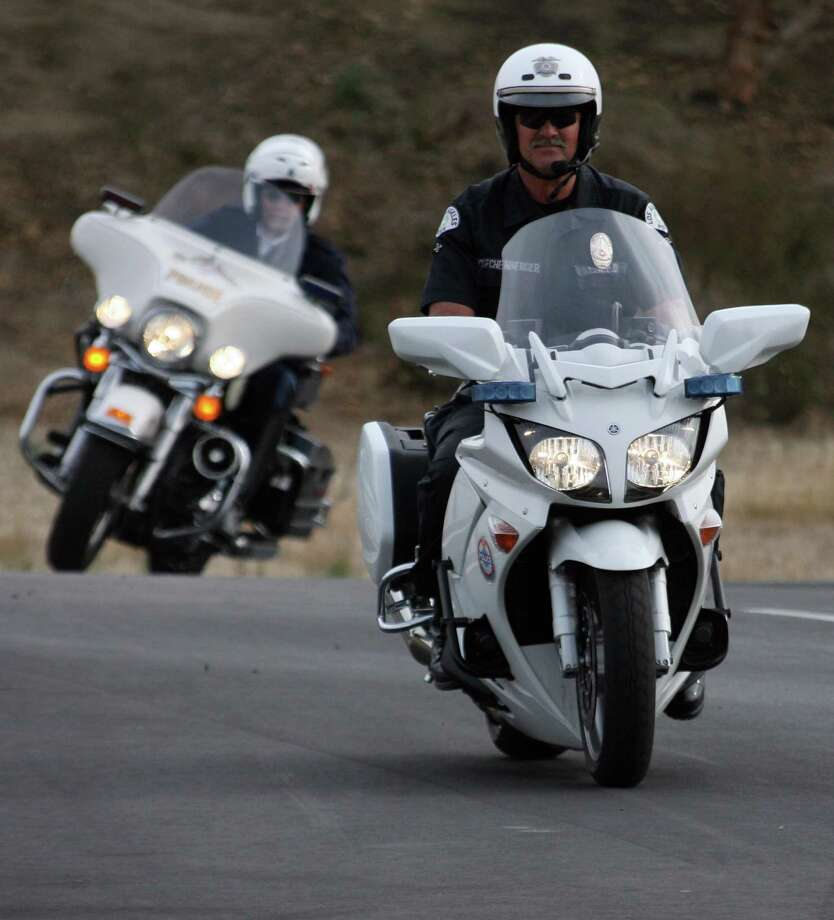 An LAPD officer takes a spin on a French Police Yamaha FJR1300, while a French officer in back rides an LAPD Harley. The FJR is a sport touring bike that is seen as competition with the BMW R1200RT bikes for public safety fleet dollars. Photo: GABRIEL BOUYS, AFP/Getty Images / 2007 AFP