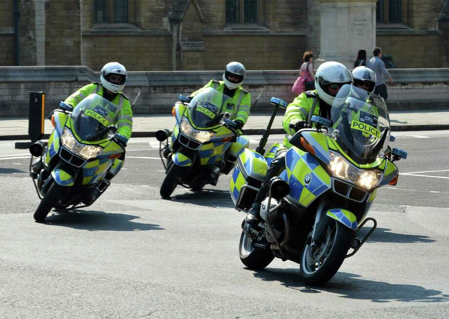 British cops riding the venerable BMW R1200RT. Photo: MARK RALSTON, AFP/Getty Images / 2012 AFP