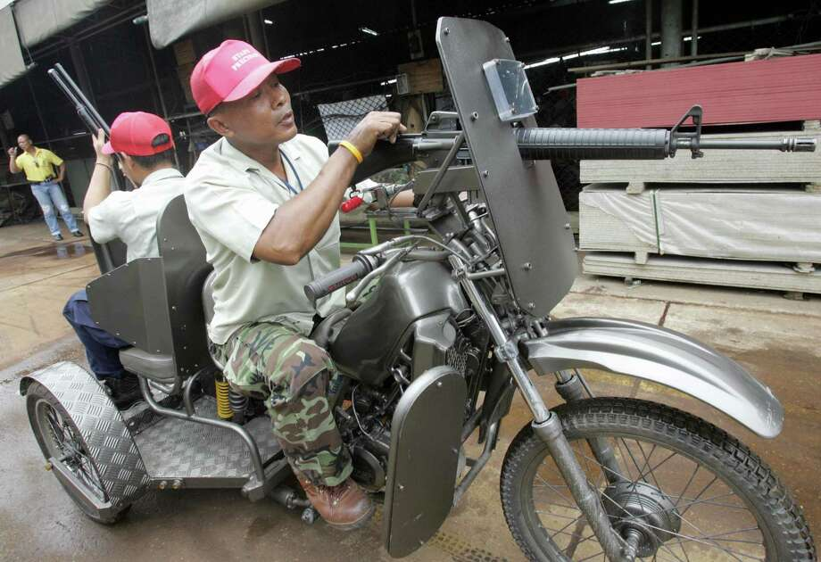 When things get hairy, Thai security forces have been known to call on one of these armored trikes. Photo: PORNCHAI KITTIWONGSAKUL, AFP/Getty Images / 2006 AFP