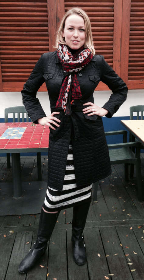 Elizabeth Ingalls loves fashion mashups, as seen in her bold black-and-white striped skirt and colorful animal print scarf over a quilted black trench. Her boots complete her chic — and on-trend — wintry look.