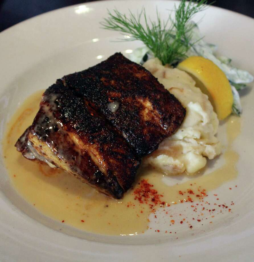 Blackened red fish at Zoko Restaurant Bar & Grill is served with caramelized Vidalia onions, mashed potatoes with cucumber and tarragon creme fraiche. Photo: Jennifer McInnis