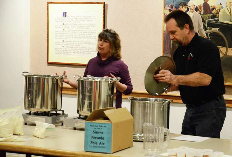 Beer recipe book authors Tess and Mark Szamatulski give a home brewing workshop at New Canaan Library Friday, Feb. 28, 2014. During the two-hour event, the couple brewed a clone of Sierra Nevada Pale Ale. Photo: Nelson Oliveira / New Canaan News