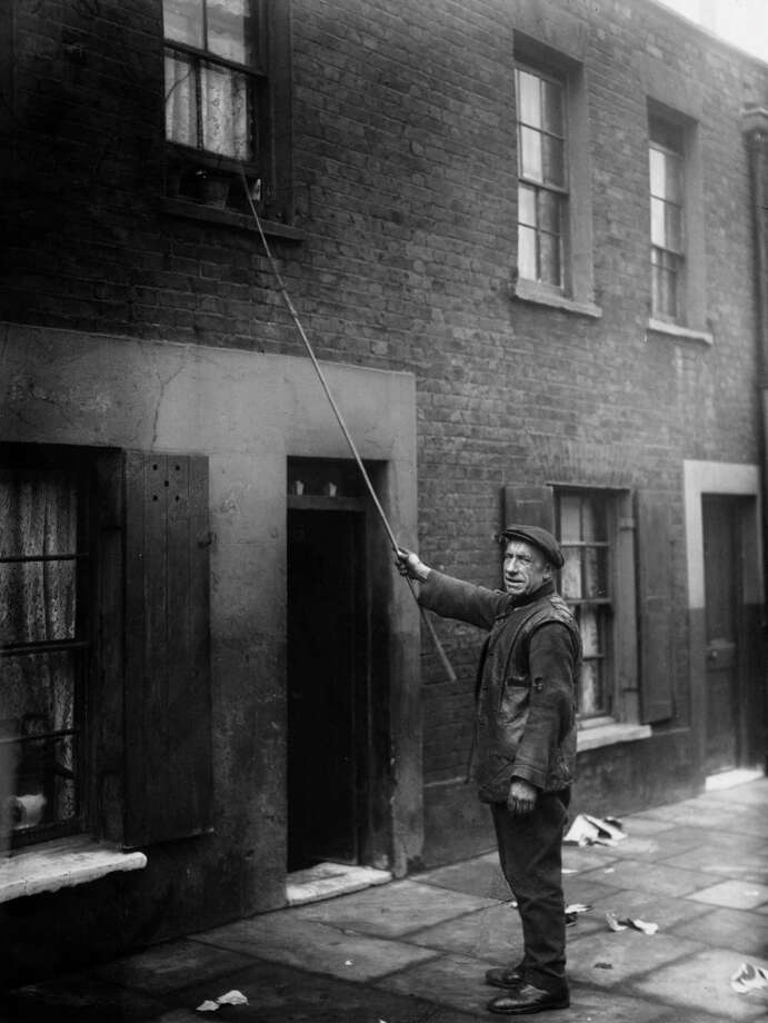 What did we do before our awful iPhone alarm clocks? Men like Charles Nelson of Hoxton in East London tapped on your window each morning to wake you up. These 'knocker-up' men and women were often employed by doctors, market traders and drivers. Photo: J. Gaiger, Getty Images / Hulton Archive