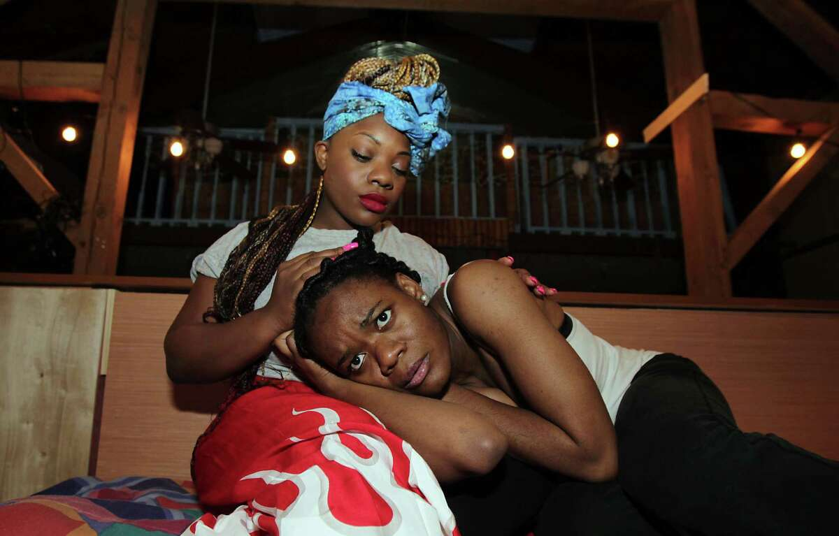 """Teri Mills top, as """"Josephine"""" and Uju Edoziem bottom, as """"Salima"""" during the Obsidian Art Space production of the Pulitzer winning play Ruined, about the plight of Congolese women Tuesday, Feb. 11, 2014, in Houston. ( James Nielsen / Houston Chronicle )"""