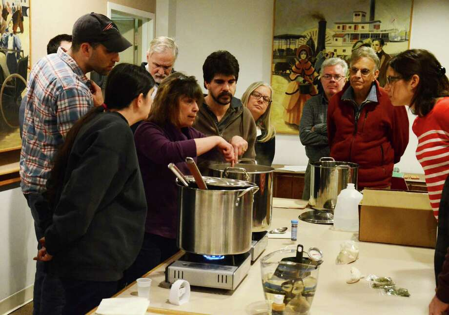 Tess Szamatulski teaches a crowd of beer enthusiasts how to brew their own beer during a workshop at New Canaan Library on Friday, Feb. 28, 2014. Photo: Nelson Oliveira / New Canaan News