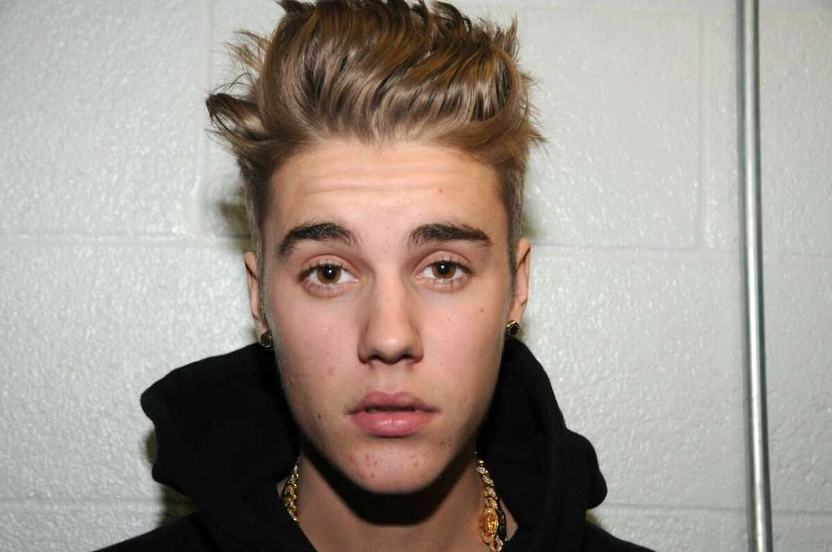 In this handout photo provided by the Miami Beach Police Department and released on March 4, 2014, singer Justin Bieber is photographed by police while in custody on January 23, 2014 in Miami Beach, Florida. Justin Bieber was arrested for driving under the influence, resisting arrest and driving without a valid driver's license.