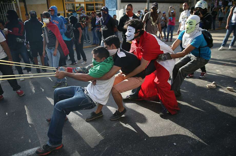 The catapult was in the shop:In Caracas, protesters resort to primitive artillery - a giant slingshot - to fight Venezuelan 
