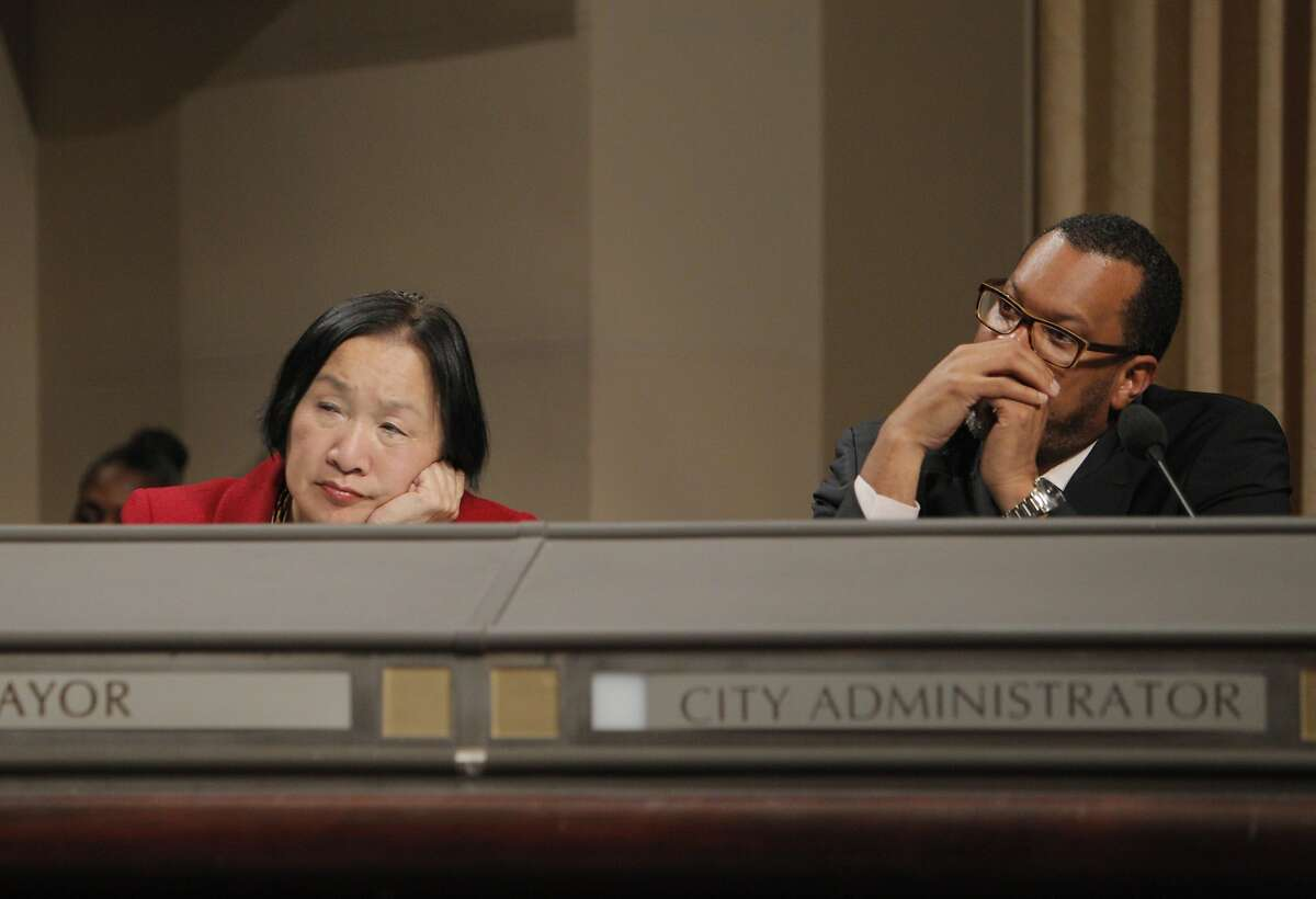 Mayor Jean Quan, left, and new city administrator Fred Blackwell listen to public comment on the DAC. Opponents of the Domain Awareness Center proposed for Oakland, Calif., came to voice their displeasure with the plan at the city council meeting on Tuesday, March 4, 2014.