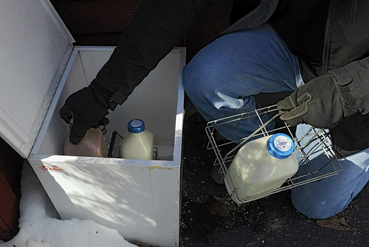 Chris Winslow, a milkman for King Bros. Dairy, delivers milk to customers Friday morning, Feb. 28, 2014, in Halfmoon, N.Y. (Lori Van Buren / Times Union)
