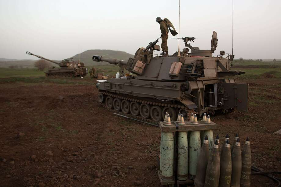 An Israeli army artillery battery unit is deployed on alert in the Golan Heights near the Syrian border. Israel has struck Syrian territory at least three times in the past year. Photo: Menahem Kahana, AFP/Getty Images