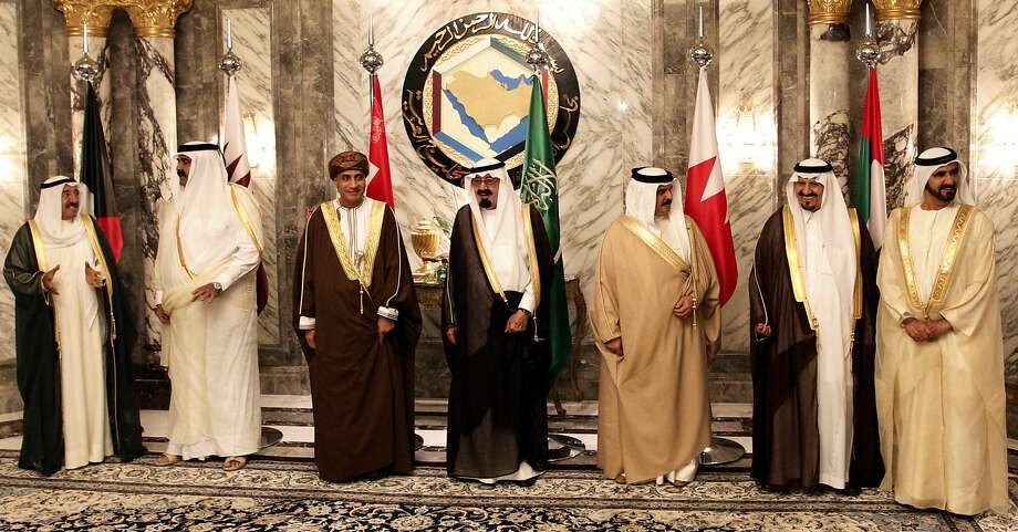FILE - In this Tuesday, May 11, 2010 file photo, Arab gulf leaders from left to right, Kuwaiti Emir Sabah Al Ahmed Al Sabah, Qatari Emir Sheik Hamad bin Khalifa Al Thani, Omani Deputy Prime Minister Fahd bin Mahmoud Al Saeed, Saudi King Abdullah bin Abd al-Aziz, Bahraini King Hamad bin Isa Al Khalifa, Saudi Crown Prince Sultan bin Abdul Aziz and Sheikh Mohammed Bin Rashid Al Maktoum, Vice President and Prime Minister of the UAE and Ruler of Dubai pose for a group photo before the opening of the Gulf Cooperation Council (GCC) consultative summit in Riyadh, Saudi Arabia. Saudi Arabia, the United Arab Emirates and Bahrain said Wednesday, March 5, 2014 that they have recalled their ambassadors from the Gulf nation of Qatar over its alleged breach of a regional security deal in the clearest sign yet of the rift among Gulf Arab countries over Islamists in the region. Tensions have been brewing between Gulf countries and Qatar since Egyptians ousted President Hosni Mubarak and Qatar's massive financial and public support for his successor, Islamist President Mohammed Morsi, stood at odds with the UAE and Saudi Arabia's policies. (AP Photo/Hassan Ammar, File) Photo: Hassan Ammar, Associated Press