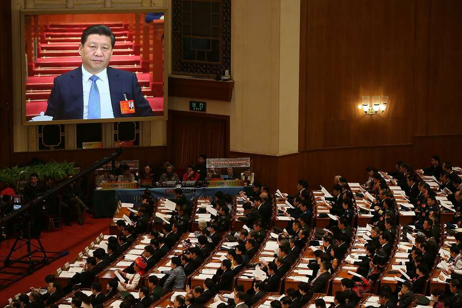 President Xi Jinping is seen on a screen as Premier Li Keqiang delivers an annual government policy speech during the opening ceremony of the National People's Congress at the Great Hall of the People in Beijing. Photo: Feng Li, Getty Images