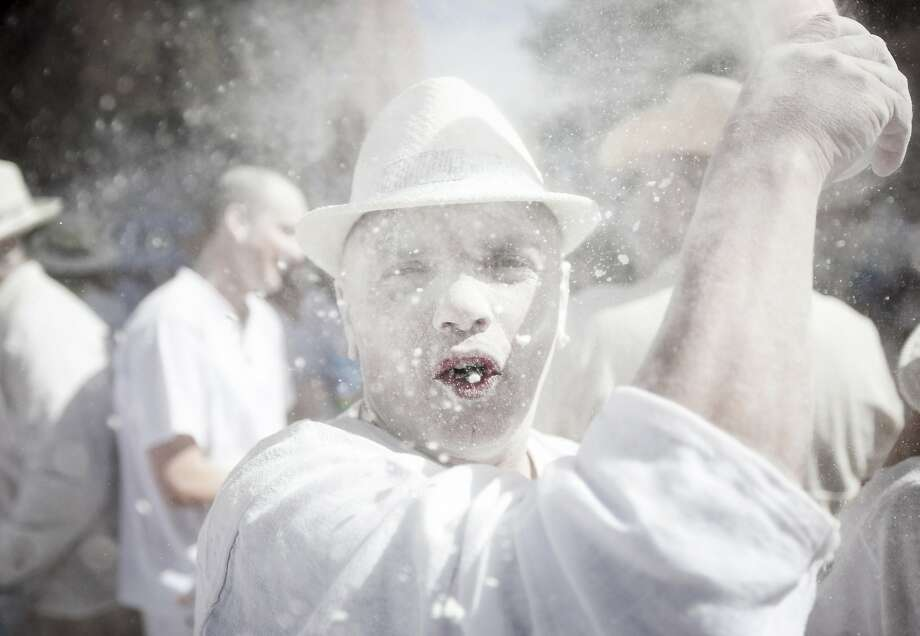 The talc of the town:Revelers known as Los Indianos spray each other with talcum powder during carnival in Santa Cruz de la Palma in the Canary islands. Los Indianos represent emigrants from the Americas who returned to the island wealthier. Photo: Andres Gutierrez, Associated Press