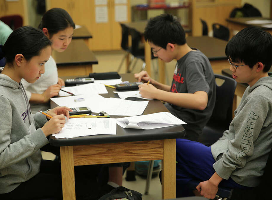 The Eastern Middle School math team works on problems during a practice session Tuesday, March 4 at Whitby School, ahead of the state MATHCOUNTS competition on Saturday, March 8. Clockwise, from top left are: Michelle Woo, Henry Shi, Steven Ma and Jovita Li. Photo: Contributed Photo / Greenwich Time