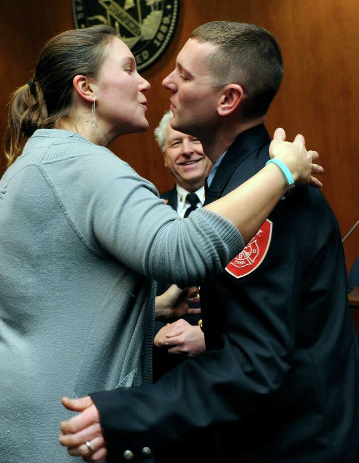 Rebecca and Gary Bruce share a kiss after his after he is sworn in as deputy fire marshal at City Hall in Danbury, Conn., Wednesday, March 5, 2014. Photo: Carol Kaliff / The News-Times
