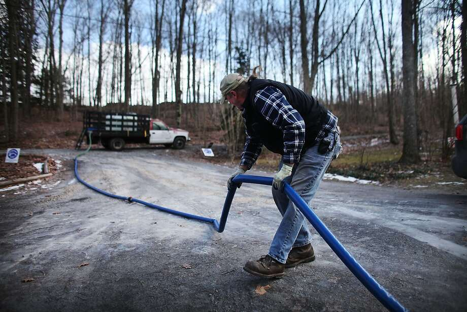 Ray Kemble delivers fresh water to a home that had its water contaminated by hydraulic fracturing in Dimock, Pa., in 2012. Photo: Spencer Platt, Getty Images