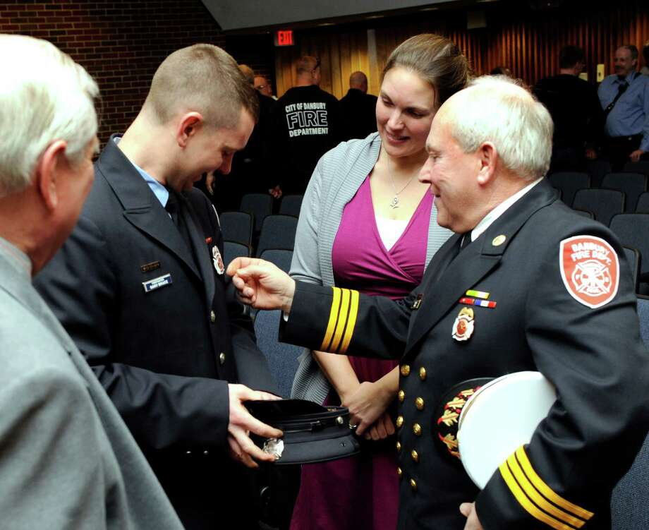 Rebecca and Gary Bruce accept congratulations after he is sworn in as deputy fire marshal at City Hall in Danbury, Conn., Wednesday, March 5, 2014. Photo: Carol Kaliff / The News-Times