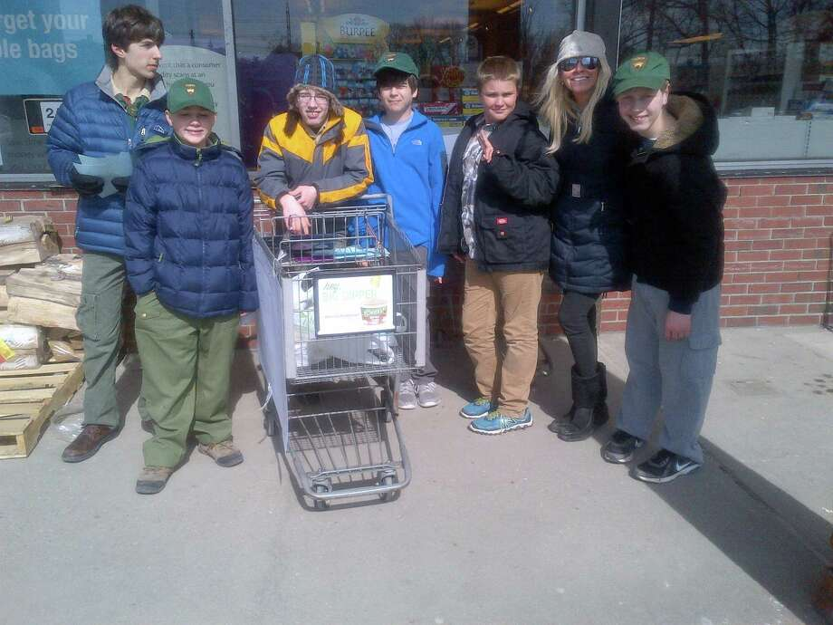 On Saturday, March 1, 50 Boy Scouts from Troop 53 in Darien fanned out to three shopping locations and dedicated several service hours to collecting food for the Person-to-Person Food Pantry. According to Pat Cage, the in-kind Manager of Person-To-Person, the record amount of food items collected by the scouts and adult volunteers will feed 50 families for a week. Shown here is the group of scouts stationed at Stop & Shop in Noroton Heights. Other volunteers were stationed at Palmerís Market and the Good Wives Shopping Center. Photo: Contributed Photo, Contributed / Darien News Contributed