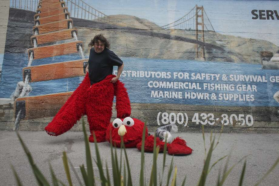 50-year-old Dan Sandler puts on his Elmo costume in Fisherman's Wharf on March 5th 2014. Sandlers has been known to go on various heated controversial rants while wearing the costume. Photo: Sam Wolson, Special To The Chronicle
