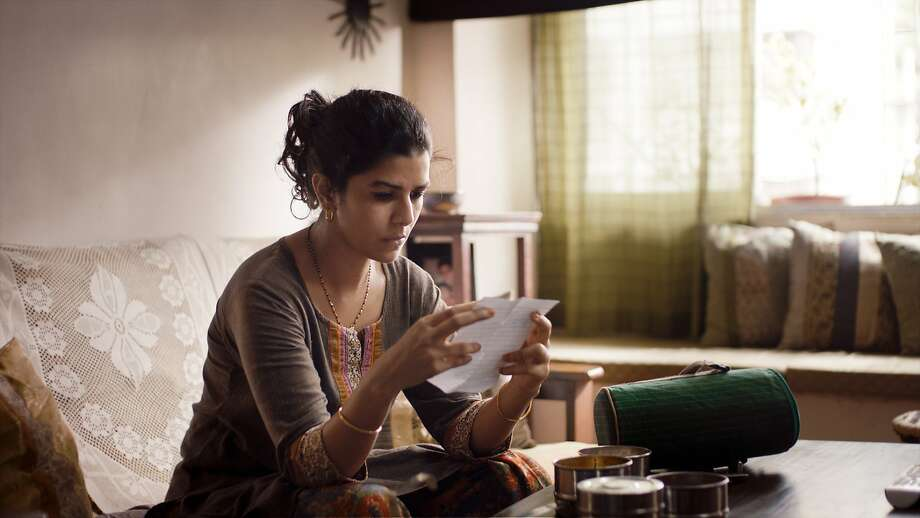 "Ila (Nimrat Kaur), who desires to revive the passion between her and her husband, makes a new friend through a delivery system error in ""The Lunchbox."" Photo: Michael Simmonds, Sony Pictures Classics"