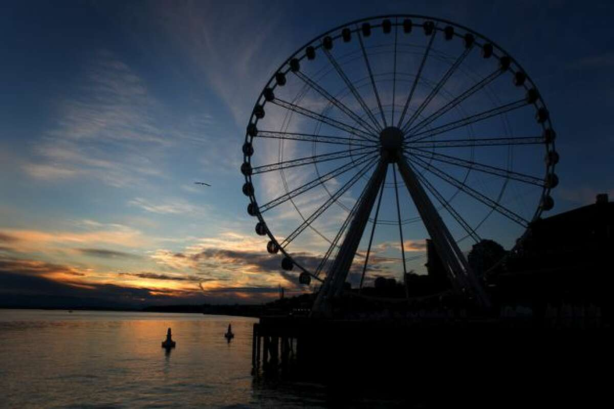 Trap: The Great Wheel Is it cruel to pick on the new kid? It's great in a lot of ways and adds some whimsy to the waterfront, but it is also the ultimate tourist trap. It's $14 for an adult ticket for those 12 and older, which is almost as much as it costs to buy a ticket to summit the Eiffel Tower. Let's avoid pretending we're something we're not.Impress a girl by buying a pair of tickets here and waiting in line. Otherwise, catch fantastic (and free) views elsewhere. And avoid the neighboring arcade that shakes you down for cash.