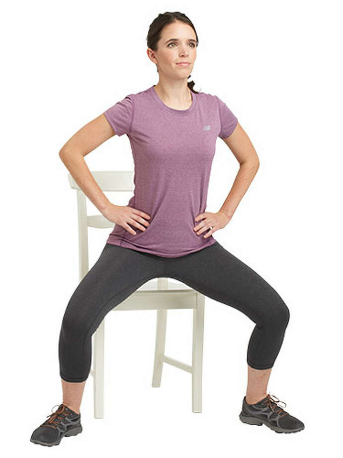 Plié Squat 1 min: Stand with back to the chair and feet wider than shoulder-width, toes turned out. Squat as if about to sit in the chair. Hold for 2 beats, then push back up to the start position. Repeat this movement. Photo: Susan Pittard/Studio D / Hearst Communications Inc., 2013