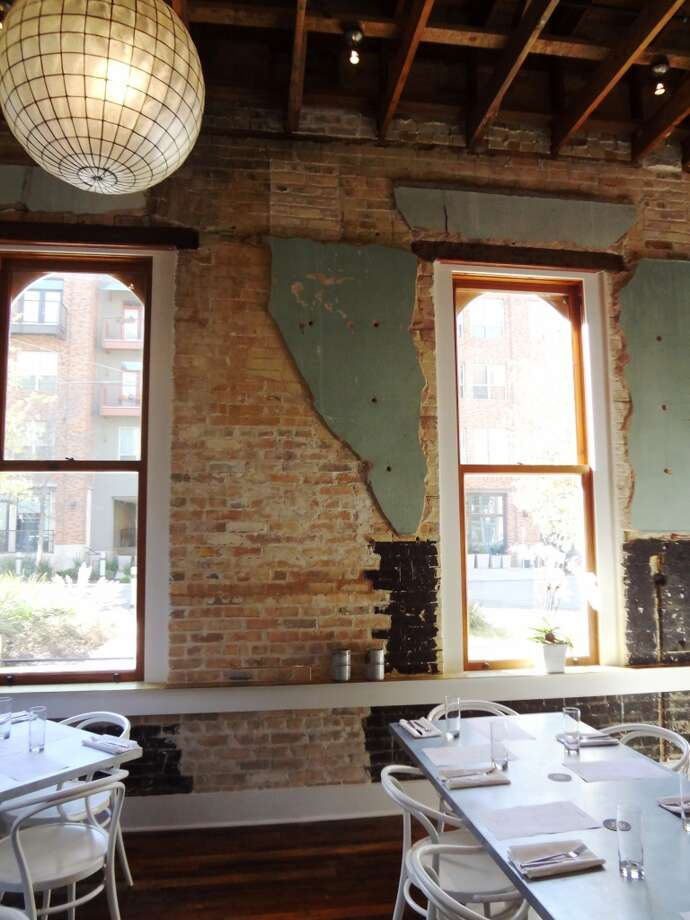 The back dining room at Cured shows the 1904 administrative building's century of use. Photo: Steve Bennett, San Antonio Express-News