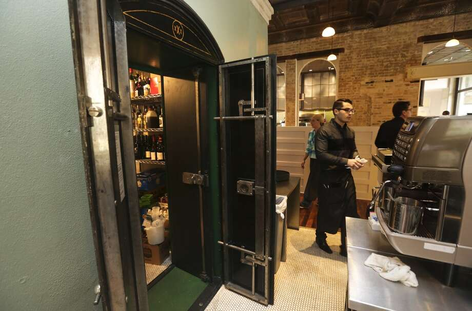 The old vault in what was the Pearl Brewery Administration Building is now used for storage behind the bar at Cured. Photo: Bob Owen, San Antonio Express-News