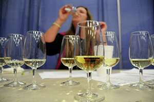 Judge Karin Violante samples a white wine at the Houston Livestock Show & Rodeo's wine competition judging at Reliant Center Saturday Nov. 09,2013.  (Dave Rossman photo)