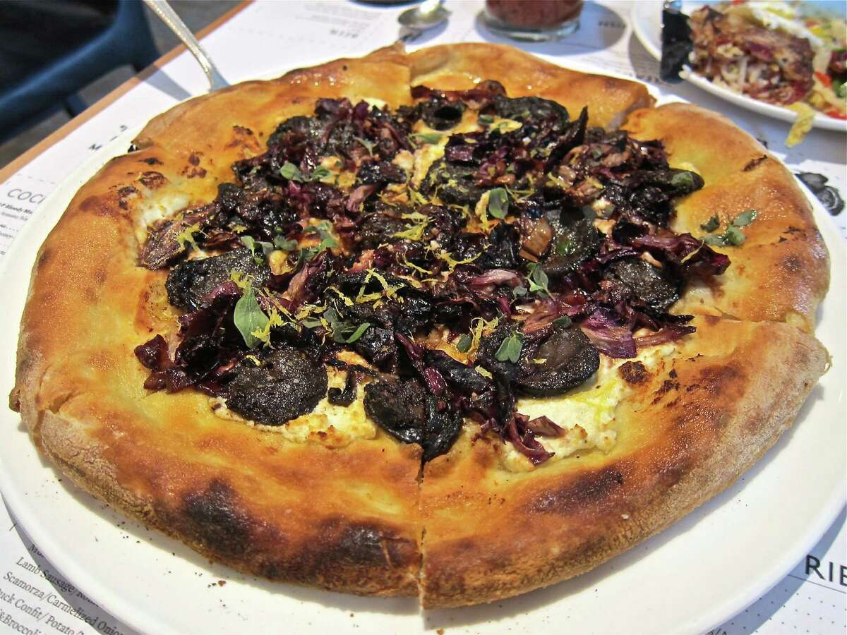 The morcilla pizza with radicchio and sheep's-milk ricotta at Provisions is entry level for brave souls looking to try a blood dish.