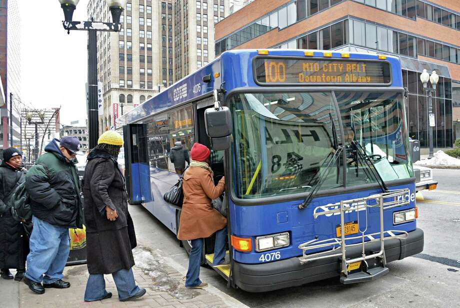 Passengers board a CDTA bus on North Pearl Street Wednesday March 5, 2014, in Albany, NY.  (John Carl D'Annibale / Times Union) Photo: John Carl D'Annibale / 00026020A