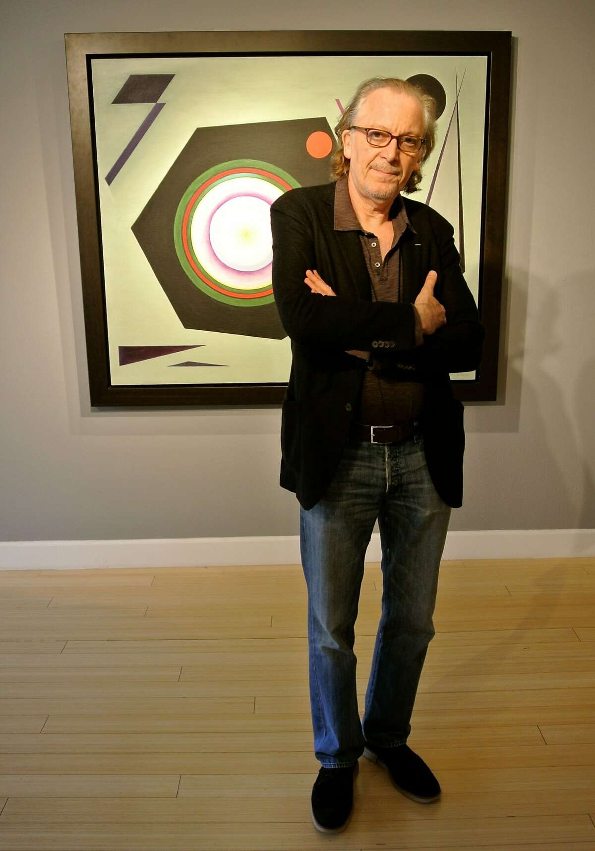 """Ronald Guttman (pictured with original artwork by Rudolf Bauer) has the title role in """"Bauer,"""" running through April 19 at San Francisco Playhouse."""