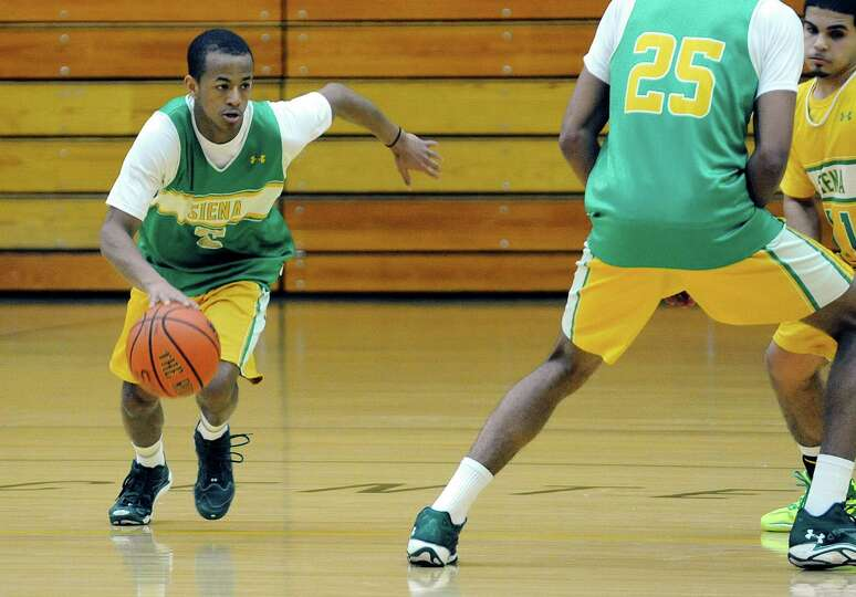 Siena men's basketball player Evan Hymes drives towards the basket during a drill at practice on Wed