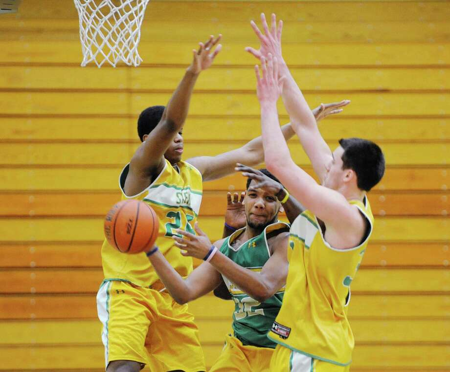 Siena men's basketball player Patrick Cole, center, looks for a teammate to pass to as fellow teammates defend during a drill at practice on Wednesday, March 5, 2014, in Loudonville, N.Y. (Paul Buckowski / Times Union) Photo: Paul Buckowski / 00026006A