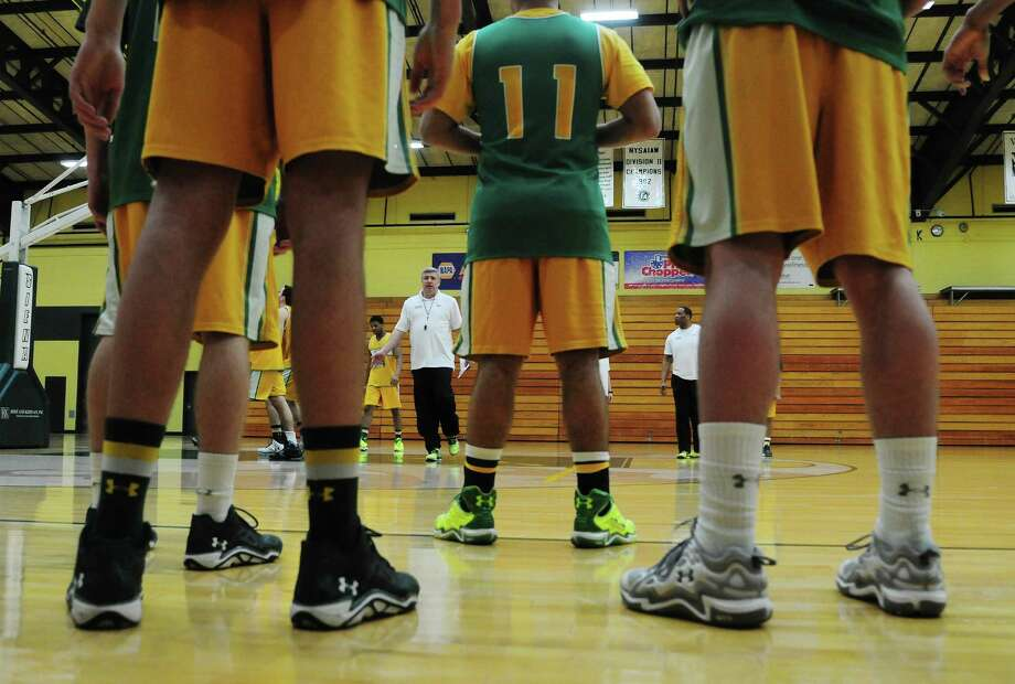 Siena men's basketball head coach Jimmy Patsos, background, talks with his players at practice on Wednesday, March 5, 2014, in Loudonville, N.Y. (Paul Buckowski / Times Union) Photo: Paul Buckowski / 00026006A