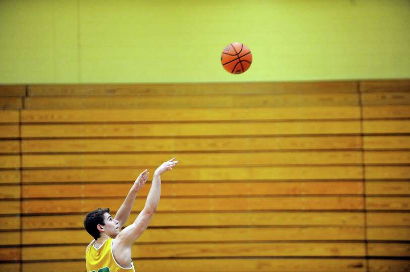 Siena men's basketball player Rob Poole shoots free throws during practice on Wednesday, March 5, 20