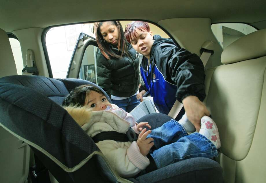 Thanks to a new law signed by Gov. Jay Inslee on Friday, your child could be sitting in a booster seat longer than previously expected once the rules go into effect on January 1, 2020 — with some reaching middle school age before they're allowed out of the booster seat. Photo: Dan DeLong, Seattlepi.com File Photo
