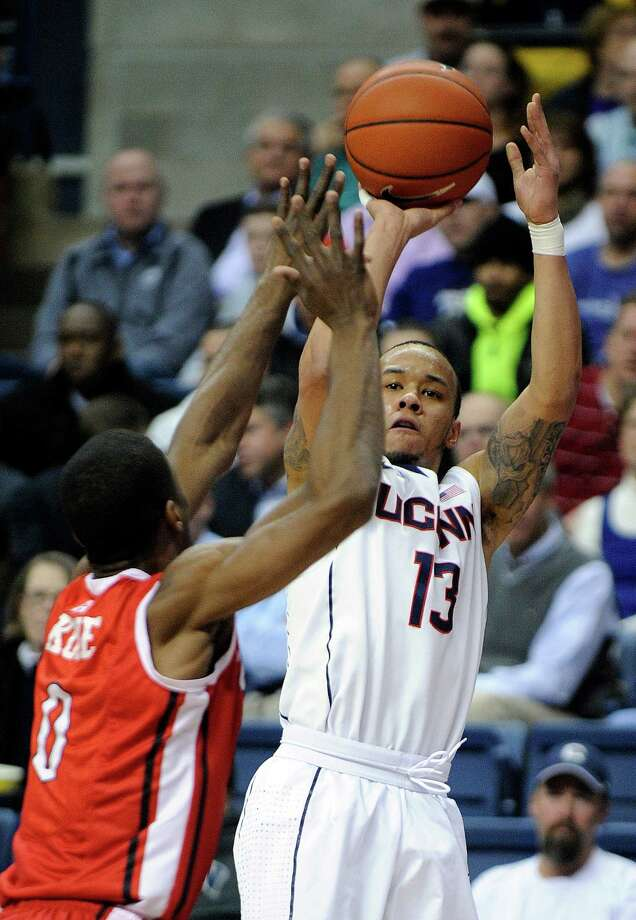 Connecticut's Shabazz Napier (13) shoots over Rutgers' Malick Kone during the first half of an NCAA college basketball game in Storrs, Conn., Wednesday, March 5, 2014. (AP Photo/Fred Beckham) Photo: Fred Beckham, Associated Press / Associated Press