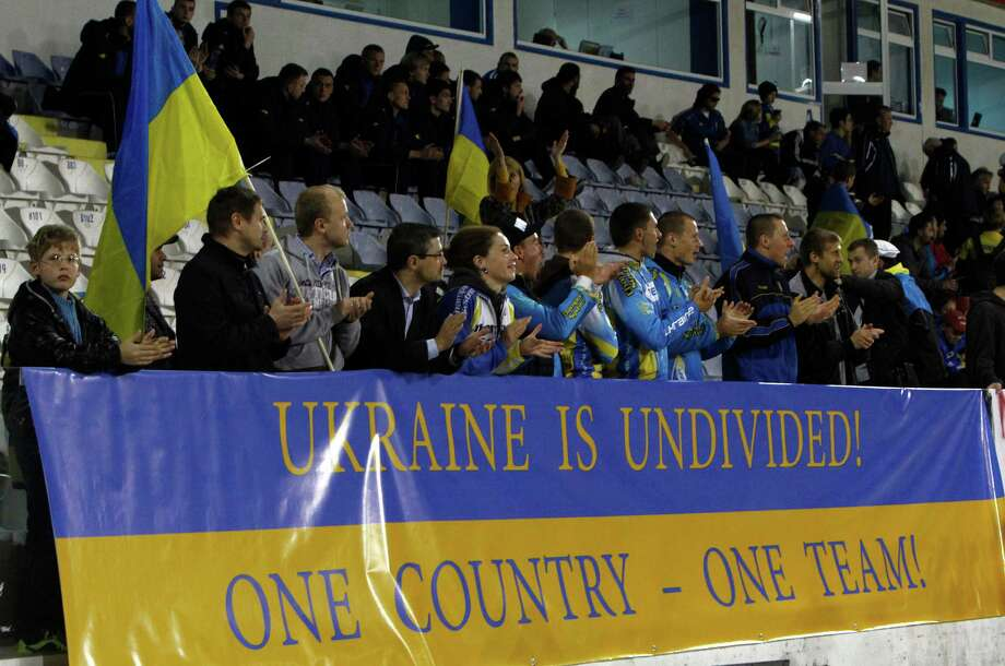 Ukrainian fans took advantage of the chance to display their national pride during Wednesday's match in Cyprus. Photo: Petros Karadjias, STF / AP