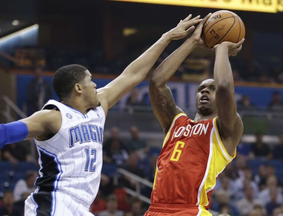 Terrence Jones (6) takes a shot over Tobias Harris (12). Photo: John Raoux, Associated Press
