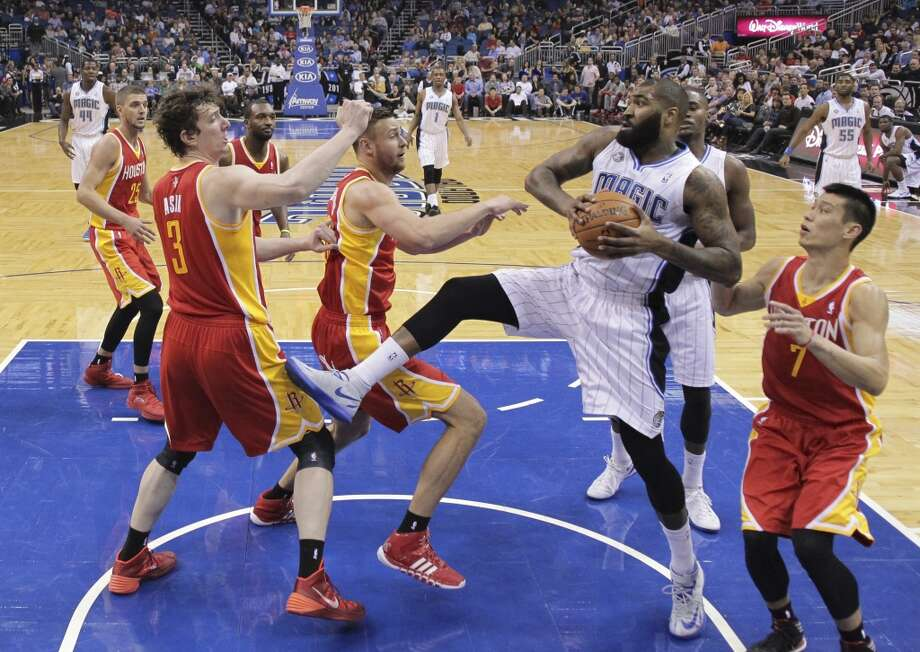 Kyle O'Quinn, second from right, grabs an offensive rebound in front of Omer Asik (3), Donatas Motiejunas, center, and Jeremy Lin (7). Photo: John Raoux, Associated Press