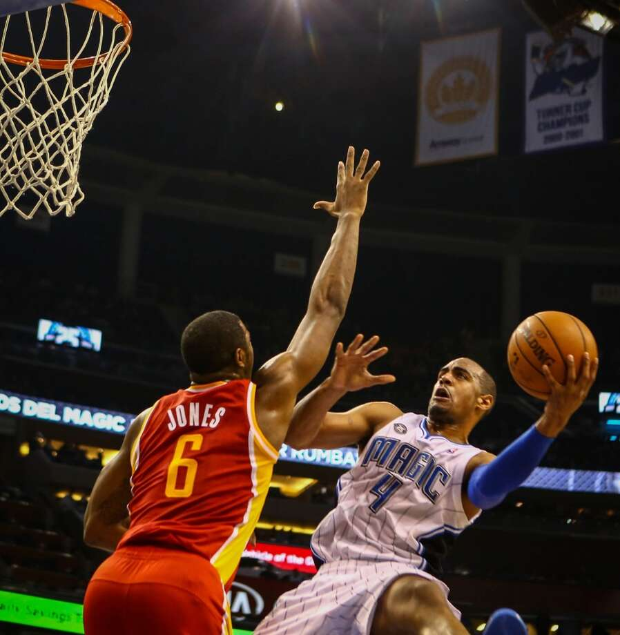 Arron Afflalo (4) drives to the basket against Terrence Jones (6). Photo: Joshua C. Cruey, McClatchy-Tribune News Service