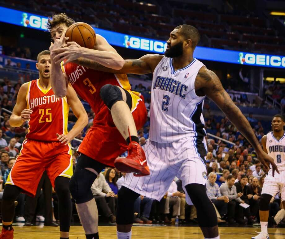 Omer Asik (3) takes a rebound away from Kyle O'Quinn (2). Photo: Joshua C. Cruey, McClatchy-Tribune News Service