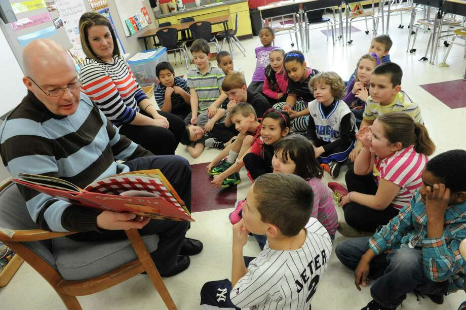 """Third grade teachers Mr. David Hamilton and Mrs. Lindsey Hunter read the book """"Enemy Pie"""" to their students during World Read Aloud Day at Rensselaer Park Elementary School on Wednesday, March 5, 2014, in Troy, N.Y.  (Lori Van Buren / Times Union) Photo: Lori Van Buren / 00025923A"""