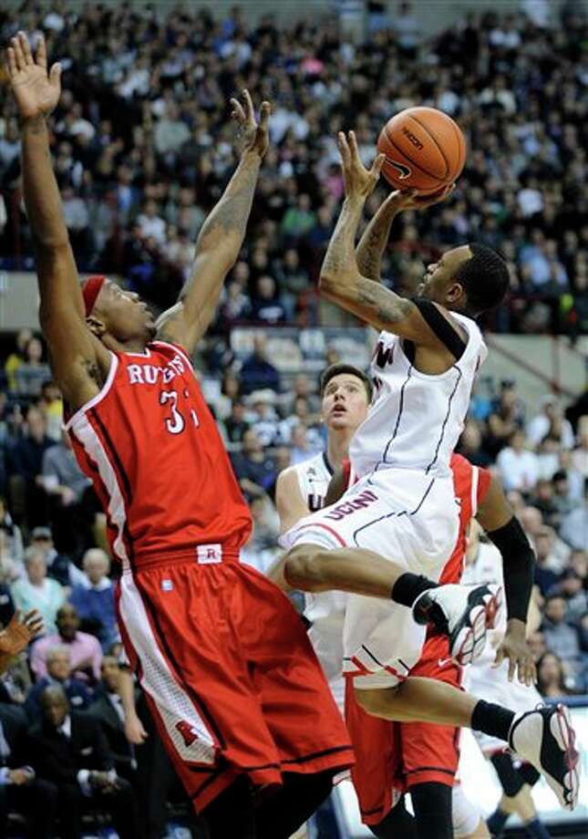 Connecticut's  Ryan Boatright (11) drives over Rutgers' Wally Judge (33) during the  second half of Connecticut's 69-63 victory in an NCAA college basketball  game in Storrs, Conn., Wednesday, March 5, 2014. (AP Photo/Fred  Beckham)
